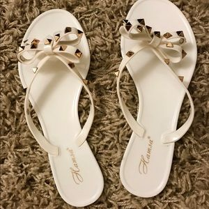 Shoes - NEW • studs & bows jelly flip flops